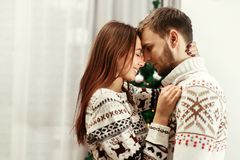 Sensual, romantic couple in warm stylish sweaters with reindeers Stock Image