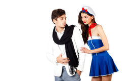 Sensual sailor woman flirting  elegant man. Young couple of sensual young women flirting with elegant confident man. Isolated on white background. High Royalty Free Stock Image