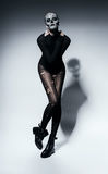 Sensual scary woman in black with shadow. In studio Stock Photos