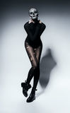 Sensual scary woman in black. In studio Stock Photography