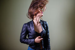 Sensual sexi brunette female in blue leather Stock Image