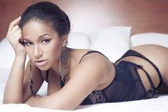 Sensual sexy african woman liyng Stock Photo