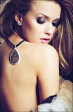 Sensual sexy girl blonde in a fur coat half the closeup with the. Decoration on the back Stock Photo