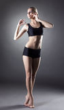 Sensual slender girl posing standing on tiptoe Royalty Free Stock Image