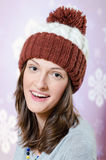 Sensual smiling brunette young girl in knitted hat Royalty Free Stock Image