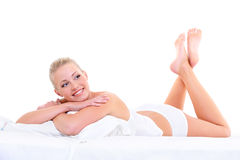 Sensual smiling woman lying on the  bed Stock Photos
