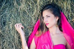 Sensual smiling young girl with pink cloth over Stock Images