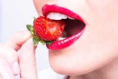 Sensual strawberry bite Royalty Free Stock Photos