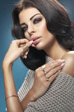 Sensual tawny woman with perfect waves of haisrtyle Stock Photos