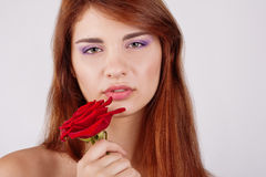 Sensual teen girl holds a rose in hand Royalty Free Stock Photos