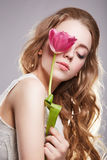 Sensual teen girl with tulip flower. Sensual beautiful teenager girl with tulip flower.beauty spring young model Stock Images