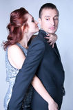 Sensual temptation. Studio portrait of sensual copule a men and a women dressed in elegant clothes, standig close to each other, hugging in temptation, feeling Royalty Free Stock Photos