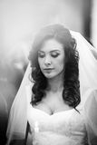 Sensual, thoughtful beautiful brunette bride holding a candle du Stock Photography