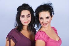 Sensual two brunettes women portrait stock image