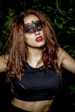Sensual venetian mask. Beautiful Teenage Model Dressed in Fashio Royalty Free Stock Photography