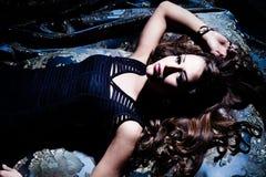 Sensual woman. Sensual young brunette woman lie down,  studio shot Stock Photography