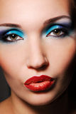 The sensual woman. Beautiful make up and bright colore