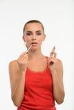 Sensual woman applying gloss on her lips. Stock Images
