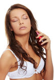 Sensual woman applying perfume on her body Stock Images