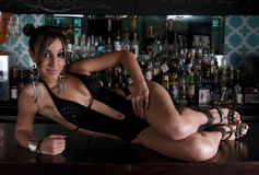 Sensual woman in a bar Royalty Free Stock Images
