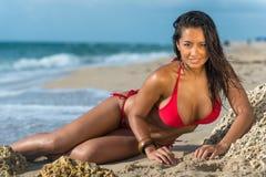 Sensual woman on the beach very happy Stock Photos