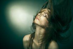 Sensual woman with beautiful long brown hairs Royalty Free Stock Image