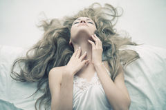 Sensual woman in bed Stock Image