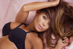 Sensual woman in bed. Stock Image