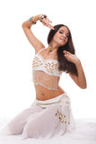 Sensual woman belly dancer in white costume Royalty Free Stock Photography