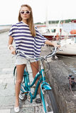 Sensual woman with bicycle Stock Images
