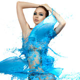 Sensual woman and big paint waves. Blue splash.  Royalty Free Stock Photo
