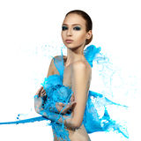 Sensual woman and big paint waves. Blue splash Royalty Free Stock Photos