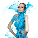 Sensual woman and big paint waves. Blue splash Stock Image