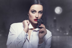 Sensual woman bite tux at night in city Royalty Free Stock Photos