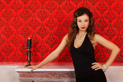 Sensual woman in black dress on red vintage background with a ca Royalty Free Stock Photos