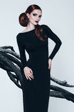 Sensual woman in black dress and trees. Sensual woman in black dress and dark trees Royalty Free Stock Photography