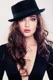 Sensual Woman in Black Hat Royalty Free Stock Images