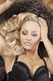 Sensual woman with blond curly hair Royalty Free Stock Photos