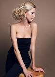 Sensual woman with blond curly hair with bright makeup Royalty Free Stock Image