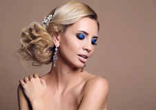 Sensual woman with blond curly hair with bright makeup Stock Image
