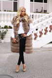Sensual woman with blond hair in luxurious fur coat Stock Photography