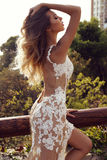 Sensual woman with blond hair in luxurious lace dress Stock Photography