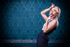 Sensual woman on blue vintage background Stock Photos