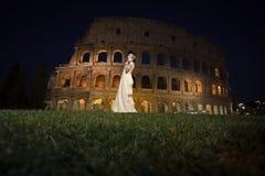 Free Sensual Woman Body. Pretty Bride Near Coliseum Stock Photography - 117027102
