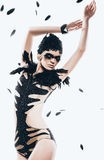 Sensual woman in bodysuit with black feathers Stock Image