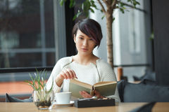 Sensual woman with book and coffee Stock Photo