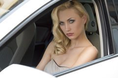 Sensual woman in a car Stock Photography