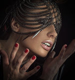 Sensual woman with chain mask Stock Image