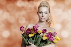 Sensual woman with colourful tulips Royalty Free Stock Photography