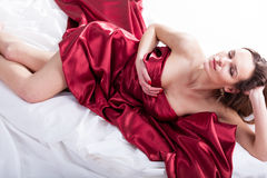 Sensual woman covered with red silk Stock Photos